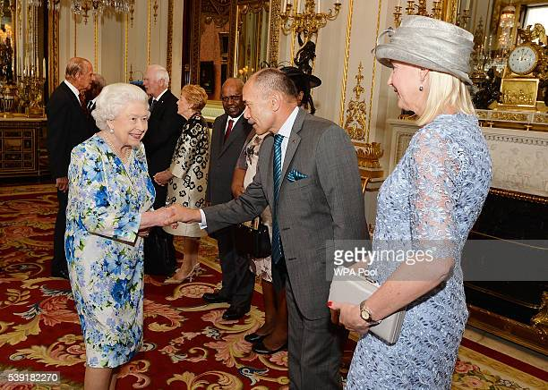 Queen Elizabeth II shakes hands with Sir Jerry Mateparae of NewZealand during a reception ahead of a lunch at Buckingham Palace on June 10, 2016 in...