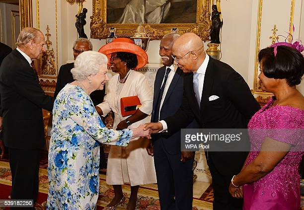 Queen Elizabeth II shakes hands with Sir Patrick Allen of Jamaica during a reception ahead of a lunch at Buckingham Palace on June 10, 2016 in...