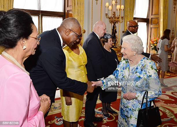 Queen Elizabeth II shakes hands with Sir Rodney Williams of Antigua and Barbuda during a reception ahead of a lunch at Buckingham Palace on June 10,...