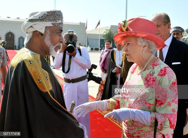 Queen Elizabeth II shakes hands with the Sultan of Oman His Majesty Sultan Qaboos bin Said before she and the Prince Phillip Duke of Edinburgh depart...
