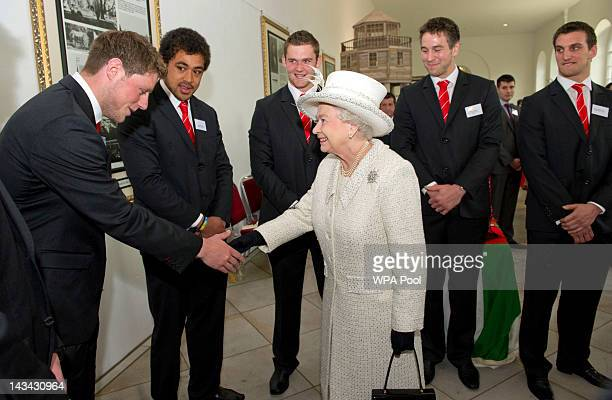 Queen Elizabeth II shakes hands with Welsh rugby player Rhys Priestland during a visit to Margam Country Park on April 26 2012 in Margam Wales The...