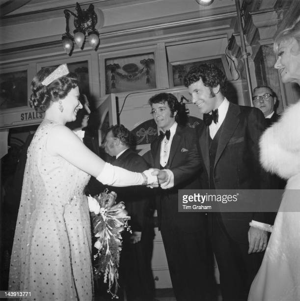 Queen Elizabeth II shakes hands with Welsh singer Tom Jones after the Royal Variety Performance at the London Palladium 10th November 1969 In the...