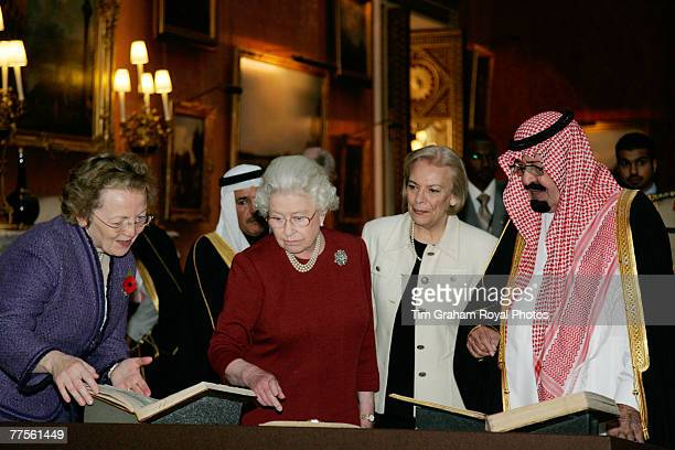 Queen Elizabeth II shows King Abdullah Bin Abdul Aziz Al Saud of Saudi Arabia items around the Royal Collection in the Picture Gallery at Buckingham...