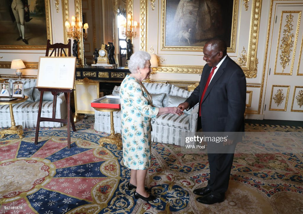 Queen Elizabeth II shows South African President Cyril Ramaphosa letters between her and Nelson Mandela on South Africa returning to the Commomwealth which was presented as a gift to him during an audience at Windsor Castle on April 17, 2018 in Berkshire, England.