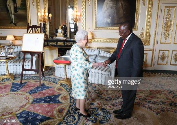 Queen Elizabeth II shows South African President Cyril Ramaphosa letters between her and Nelson Mandela on South Africa returning to the Commomwealth...