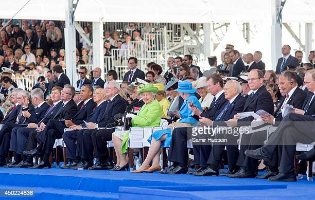 Queen Elizabeth II sits among Heads of State including US President Barack Obama and Prince Albert of Monaco as they attend a Ceremony to Commemorate...
