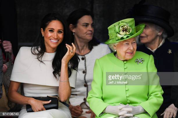 Queen Elizabeth II sits and laughs with Meghan Duchess of Sussex accompanied by Samantha Cohen during a ceremony to open the new Mersey Gateway...