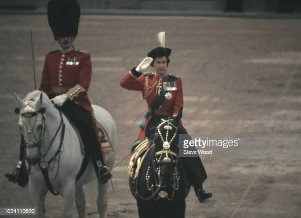 Queen Elizabeth II sits astride her horse Burmese as she makes her way from Buckingham Palace along the Mall to Horse Guards Parade during the...