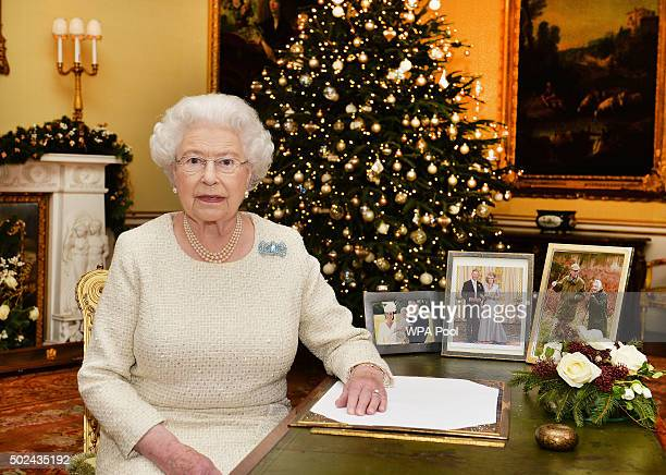 Queen Elizabeth II sits at a desk in the 18th Century Room at Buckingham Palace after recording her Christmas Day broadcast to the Commonwealth on...