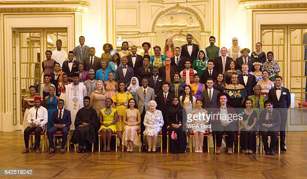 Queen Elizabeth II sits for a group photo with the sixty winners of the Queen's Young Leaders Awards at Buckingham Palace in London Front row left to...