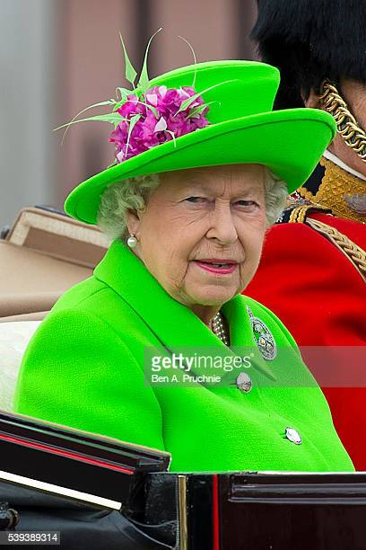 Queen Elizabeth II sits in a carriage during the Trooping the Colour, this year marking the Queen's 90th birthday at The Mall on June 11, 2016 in...