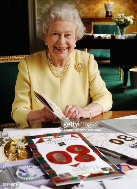 Queen Elizabeth II sits in the Regency Room at Buckingham Palace as she looks at some of the cards which have been sent to her for her 80th birthday...