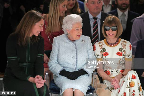 Queen Elizabeth II sits next to Anna Wintour and Caroline Rush chief executive of the British Fashion Council as they view Richard Quinn's runway...