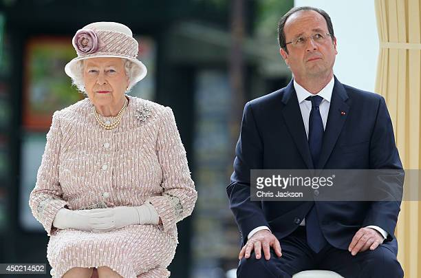 Queen Elizabeth II sits next to President of France Francois Hollande as they visit Paris Flower Market on June 7 2014 in Paris France Queen...