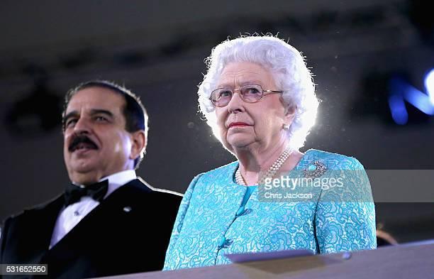 Queen Elizabeth II sits next to the King of Bahrain Hamad bin Isa Al Khalifa on the final night of Queen Elizabeth II's 90th Birthday Celebrations at...
