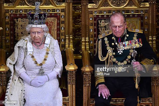 Queen Elizabeth II sits on the throne in the House of Lords next to Prince Philip, Duke of Edinburgh during the State Opening of Parliament in the...