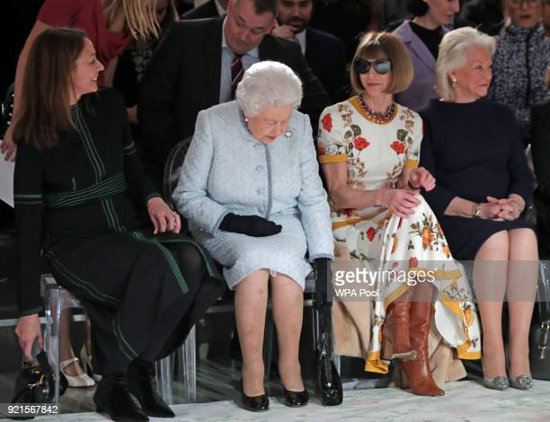 Queen Elizabeth II sits with Anna Wintour Caroline Rush chief executive of the British Fashion Council and royal dressmaker Angela Kelly as they view...