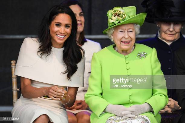 Queen Elizabeth II sits with Meghan Duchess of Sussex during a ceremony to open the new Mersey Gateway Bridge on June 14 2018 in the town of Widnes...