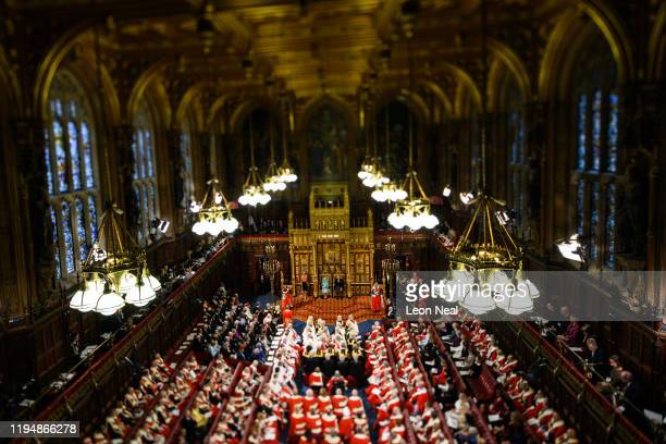 Queen Elizabeth II sits with Prince Charles Prince of Wales as she delivers the Queen's Speech in the House of Lord's Chamber on December 19 2019 in...