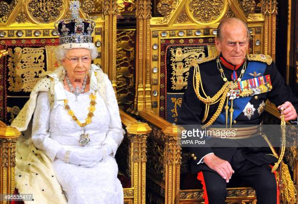 Queen Elizabeth II sits with Prince Philip Duke of Edinburgh as she delivers her speech during the State Opening of Parliament in the House of Lords...