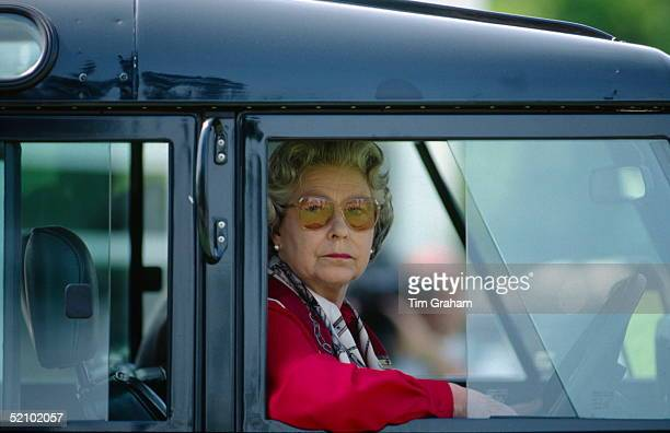 Queen Elizabeth II Sitting At The Wheel Of Her Four Wheel Drive Land Rover Car Watching People Competing At The Royal Windsor Horse Show