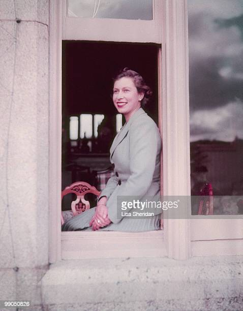Queen Elizabeth II sitting in the window at Balmoral Castle in Scotland on 9 September 1952