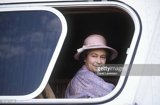 Queen Elizabeth II sitting on a coach to tour the Sicarsta Steel Works on February 18 1983 in Acapulco Mexico Queen Elizabeth II was on a Royal Tour...