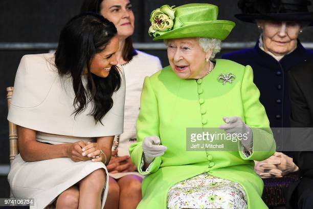 Queen Elizabeth II sitts and laughs with Meghan Duchess of Sussex during a ceremony to open the new Mersey Gateway Bridge on June 14 2018 in the town...