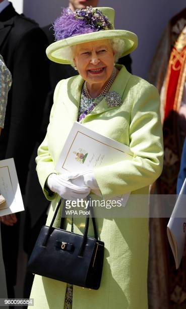 Queen Elizabeth II smiles after the wedding of Prince Harry and Meghan Markle at St George's Chapel at Windsor Castle on May 19 2018 in Windsor...