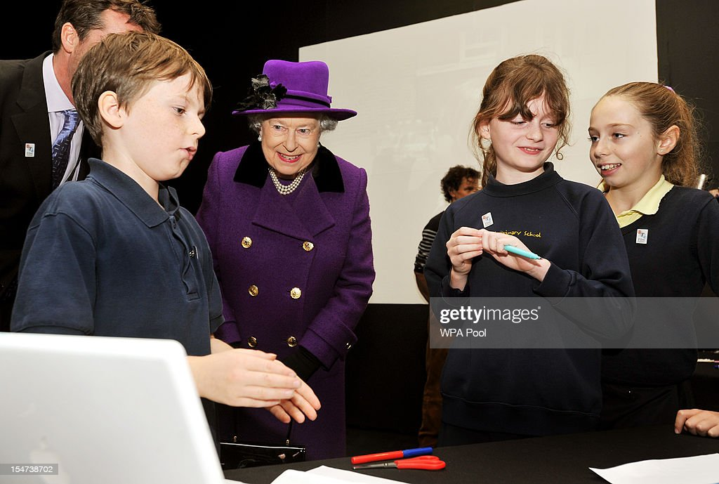 Queen Elizabeth II smiles as school children recall the Thames Diamond Jubilee Pageant during a visit to the British Film Institute on October 25, 2012 on the Southbank in London, England.