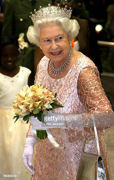 Queen Elizabeth II smiles as she arrives for a State Banquet at State House on November 22 2007 in Entebbe Uganda The Queen will open the...