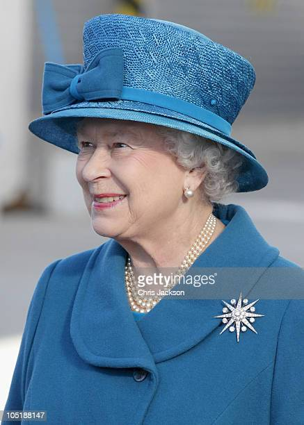 Queen Elizabeth II smiles as she arrives to name Cunard's new cruise-liner Queen Elizabeth II in Southampton Docks on October 11, 2010 in...