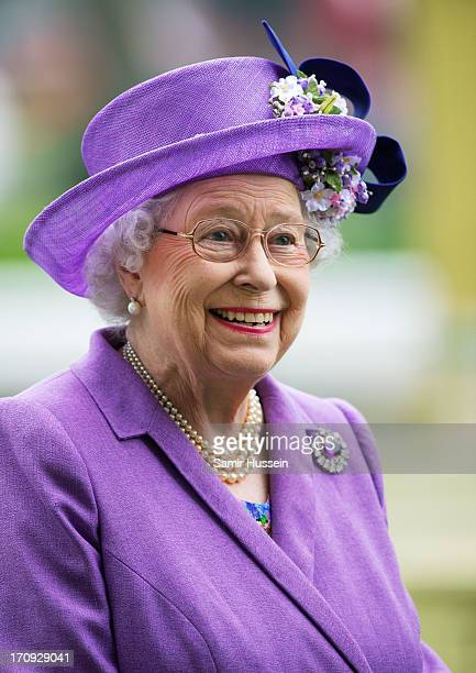Queen Elizabeth II smiles as she attends Ladies Day on day 3 of Royal Ascot at Ascot Racecourse on June 20 2013 in Ascot England