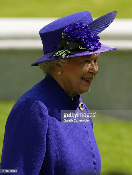 Queen Elizabeth II smiles as she attends the opening of the Diana Memorial Fountain in memory of the late Princess Diana at the south side of the...