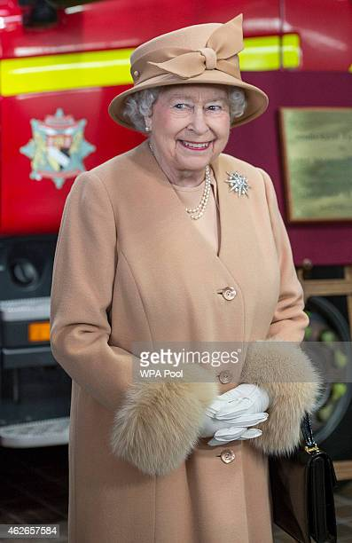 Queen Elizabeth II smiles as she formally opens the new South Lynn Fire Station on February 2 2015 in King's Lynn Norfolk England