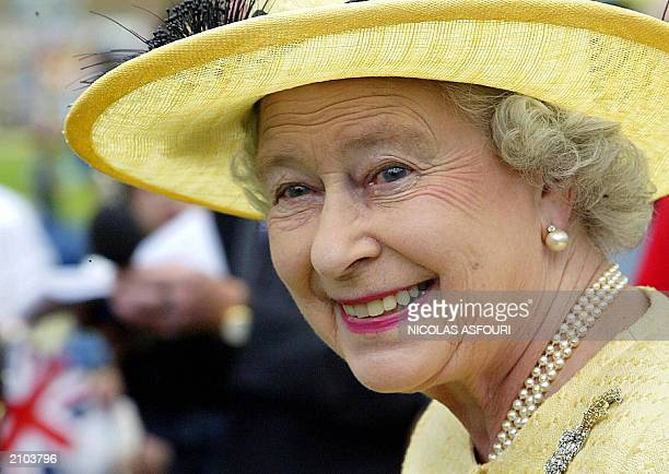 Queen Elizabeth II smiles as she invited 500 children from Barnado's and the London taxi driver's fund for unprivileged children to attend a...
