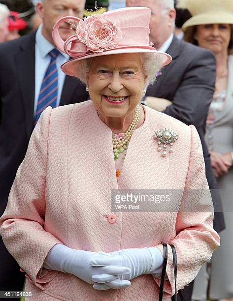 Queen Elizabeth II smiles as she is guest of honour at a garden party hosted by the Secretary of State for Northern Ireland held at Hillsborough...