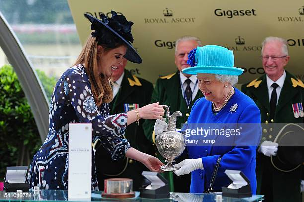Queen Elizabeth II smiles as she is presented the Hardwicke Stakes trophy by Princess Beatrice after her owned horse Dartmouth wins during Day Five...