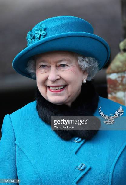 Queen Elizabeth II smiles as she leaves St Mary Magdalene Church after attending the traditional Christmas Day church service on December 25, 2012 in...