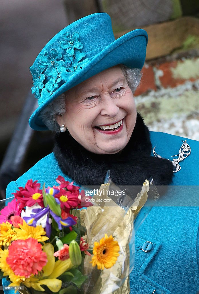 Queen Elizabeth II smiles as she leaves St Mary Magdalene Church after attending the traditional Christmas Day church service on December 25, 2012 in Sandringham, near King's Lynn, England.