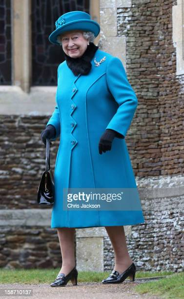 Queen Elizabeth II smiles as she leaves St Mary Magdalene Church after attending the traditional Christmas Day church service on December 25 2012 in...