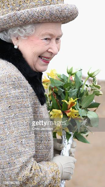 Queen Elizabeth II smiles as she leaves the Sunday Service at West Newton Church on February 5, 2012 in King's Lynn, England. Monday 6th February...