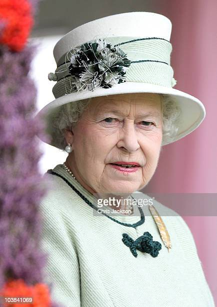 Queen Elizabeth II smiles as she looks out from the royal box during the Braemar Highland Games at The Princess Royal and Duke of Fife Memorial Park...