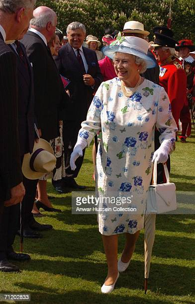 Queen Elizabeth II smiles as she meets Grenadier Guards and their families gathered to mark the 350th anniversary of the Grenadier Guards on the...