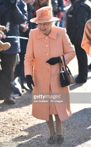 Queen Elizabeth II smiles as she meets members of the public following a Sunday church service at St Peter and St Paul in West Newton Norfolk