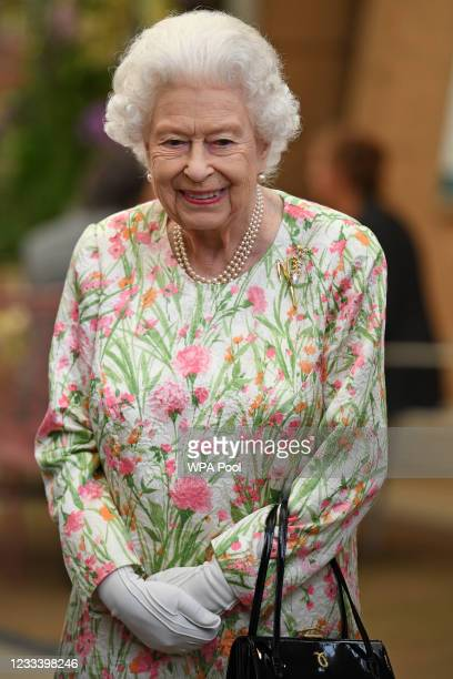 Queen Elizabeth II smiles as she meets people from communities across Cornwall during an event in celebration of The Big Lunch initiative at The Eden...