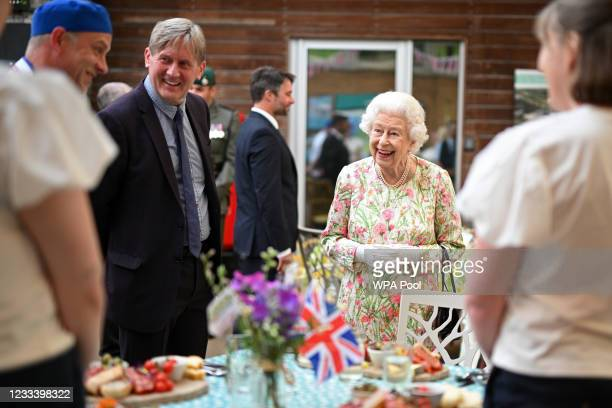 Queen Elizabeth II smiles as she meets people from communities across Cornwall at an event in celebration of The Big Lunch initiative at The Eden...