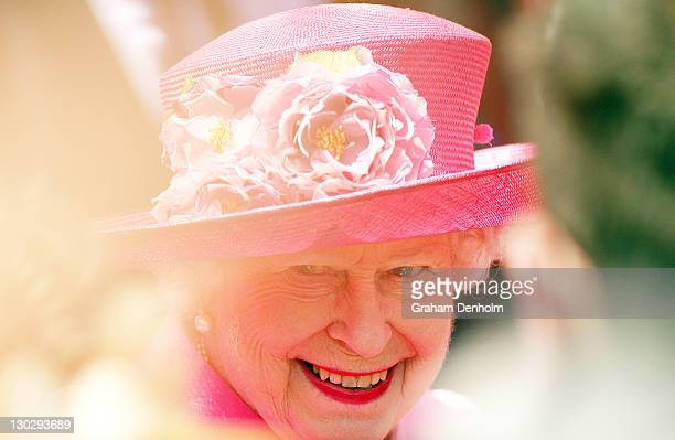 Queen Elizabeth II smiles as she meets well-wishers as she visits Federation Square on October 26, 2011 in Melbourne, Australia. The Queen and Duke...