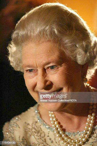 Queen Elizabeth II smiles as she mingles with guests at the ITV 50th Anniversary celebration on Thursday October 13 2005