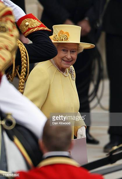 Queen Elizabeth II smiles as she prepares to make the journey by carriage procession to Buckingham Palace after the Royal Wedding of Prince William...